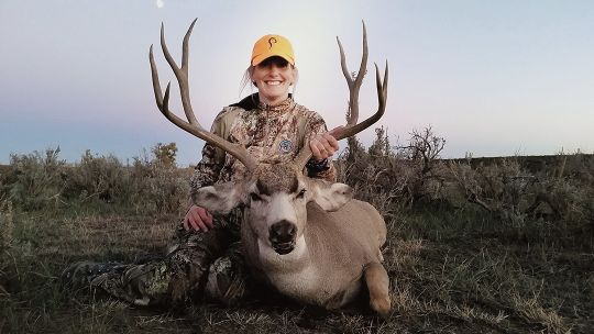 Cindi Baudhuin is all smiles with a tremendous public land buck shot in her home state of Wyoming.